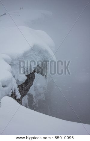 Two people in winter storm on mountain