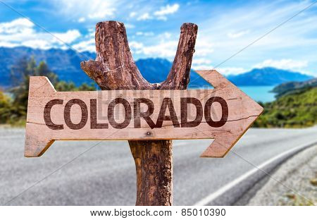 Colorado wooden sign with a road background