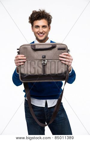 Smiling young business man presenting laptop bag
