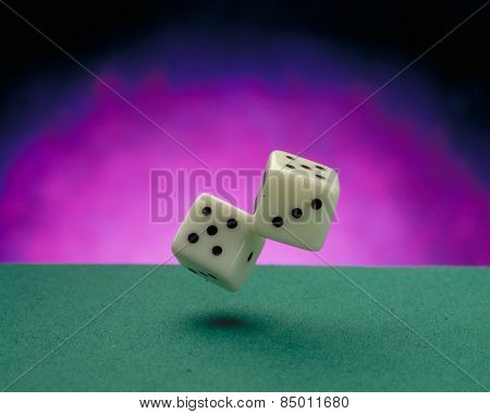 Throwing dices on a green casino felt.