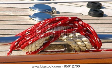 red boater's rope attached to cleat on boat