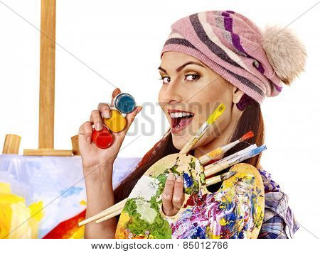 Face of artist woman with paint palette. Paiting in hand.