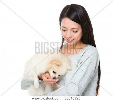 Woman feed her dog