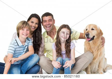 Portrait of happy family with golden retriever against white background