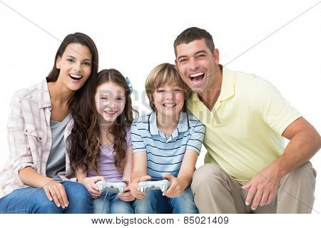 Portrait of happy family playing video game together over white background
