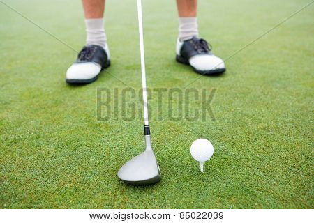 Golfer about to tee off at the golf course