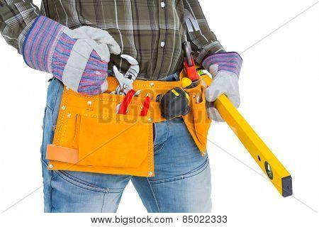 Handyman holding spirit level on white background