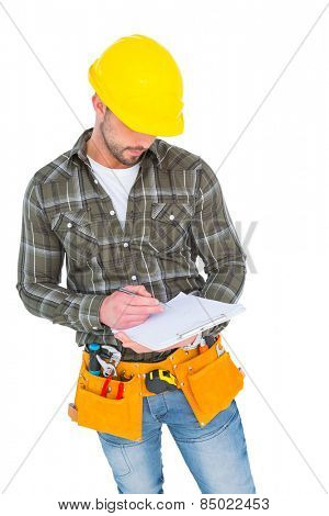 Manual worker writing on clipboard over white background