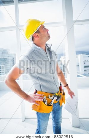 Male supervisor with clipboard inspecting building