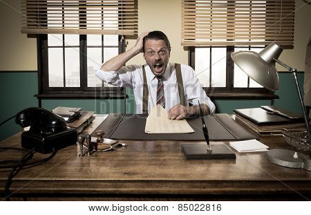 Shocked Businessman Checking Paperwork