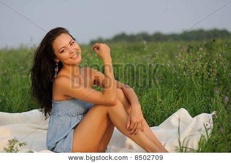 Girl Sitting On Green Grass