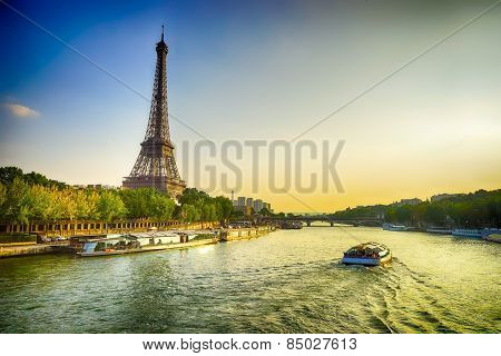 Eiffel Tower and Seine river in the evening