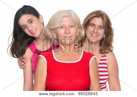 Happy family of three generations of hispanic women isolated on white