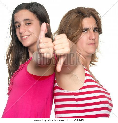 Family conflict - Teenage girl and her mother doing tumbs up, tumbs down hand gestures isolated on white