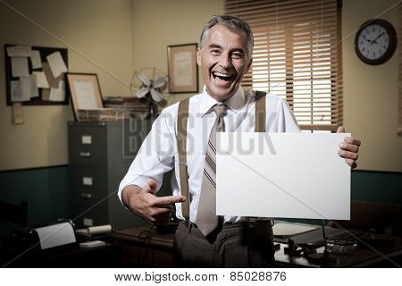 Smiling Vintage Businessman Holding A Blank Sign