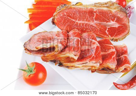 fresh roasted meat rolls and chunk on white platter