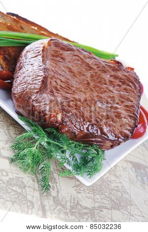 beef served with vegetables on white plate with placement