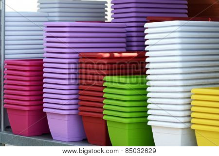 Colorful Flower Plant Pots Piled On The Table