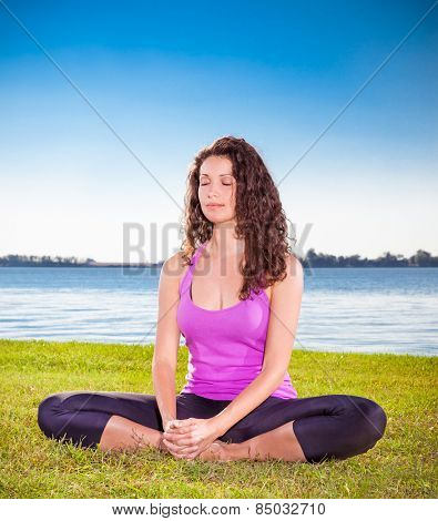 Beautiful young woman has a meditation on yoga class. Yoga concept.