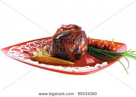 beef meat on red plate with chives and peppers