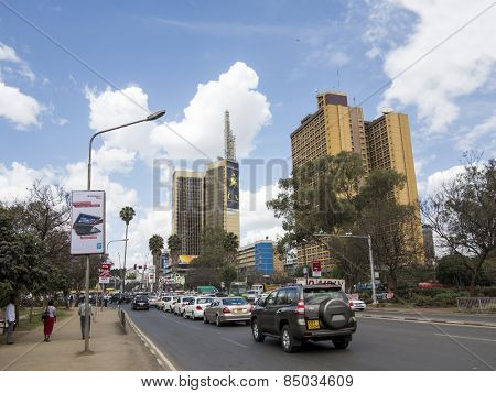 NAIROBI, KENYA-SEPTEMBER 15, 2014: Unidentified people walk in the downtown area with heavy traffic in Nairobi, Kenya