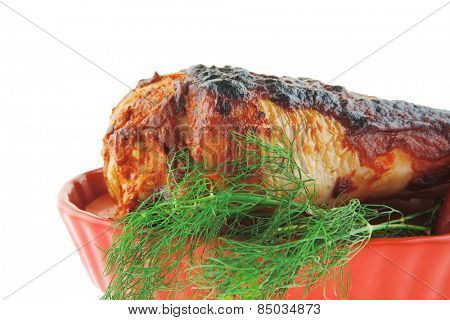 grilled drumstick with greenery on white background