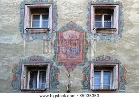 ST. WOLFGANG, AUSTRIA - DECEMBER 14: Virgin Mary with baby Jesus painting on house facade in St. Wolfgang on Wolfgangsee in Austria on December 14, 2014.