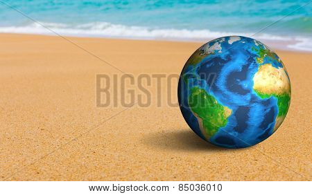 Earth globe on the sea beach (Elements of this image furnished by NASA)