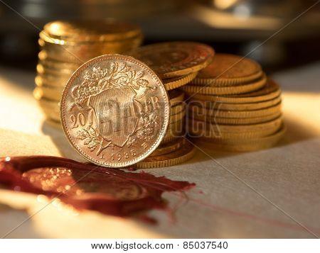 Twenty Swiss Francs gold coins Antique parchment paper sheets