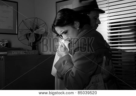 Man Consoling A Young Woman In His Office