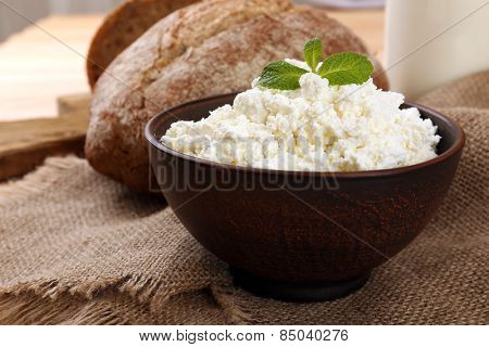 Tasty dairy products with bread on table close up