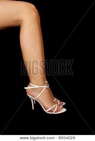 Woman's legs in stilettos