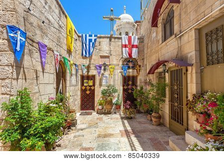 JERUSALEM, ISRAEL - JULY 10, 2014: Backyard view of Gethsemane Metoxion - Greek Orthodox monastery located near Church of the Holy Sepulchre, the holiest place for christians in Jerusalem.