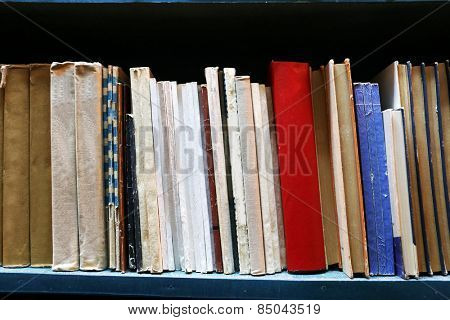 Old used books on bookshelf in library