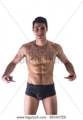 Young Man In Underwear Pointing Fingers At Empty Blank Space For Copy