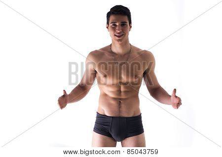 Young Man In Underwear Holding Empty Blank Space For Copy Between Hands