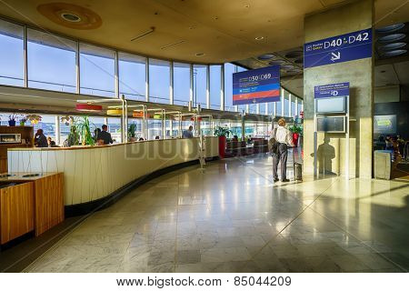 PARIS, FRANCE - SEPTEMBER 10, 2014: Charles de Gaulle Airport interior. Paris Charles de Gaulle Airport, also known as Roissy Airport, is one of the world's principal aviation centres