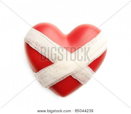 Tied heart with bandage isolated on white
