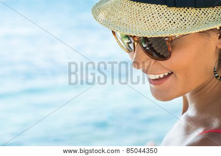 Closeup Of Smiling Young Woman Wearing Sunglasses