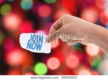 Join Now piece of paper with bokeh background