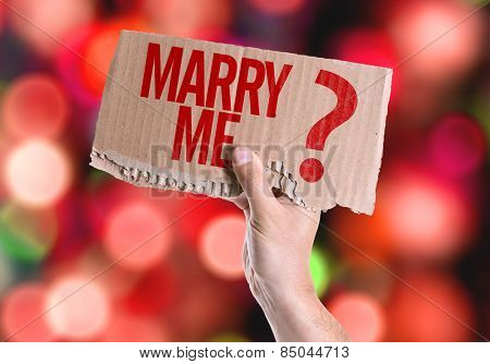 Marry Me? card with colorful background with defocused lights