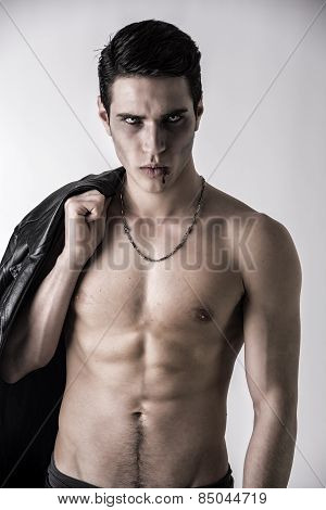 Young Vampire Man With Black Leather Jacket On Shoulder