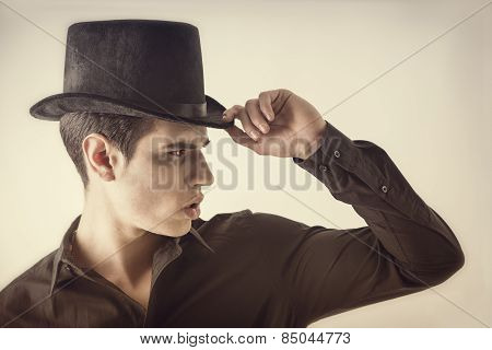 Portrait Of A Young Vampire Man With Black Shirt And Top Hat