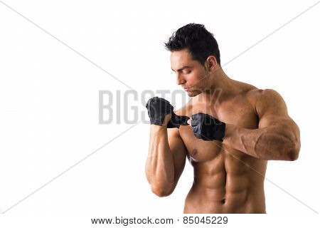 Topless Muscled Man Wearing Gloves For Workout