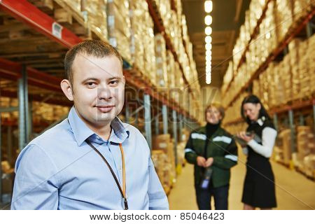 male manager and workers in warehouse