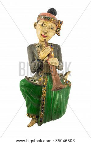 Asian vintage wood carving doll playing clarinet