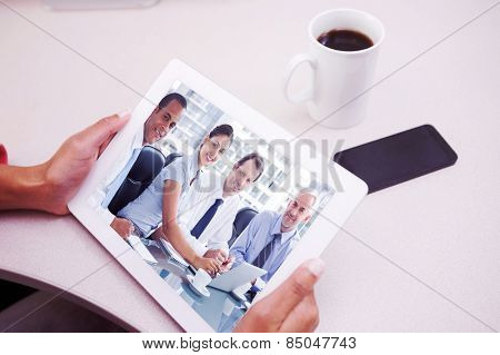 Woman using tablet pc against business people brainstorming