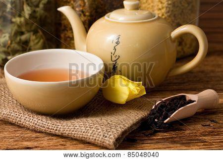 Oriental Tea Set On Jute Cloth And Tulip Bloom