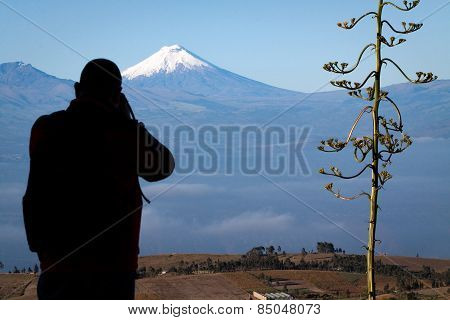 Tourist observing majestic Cotopaxi volcano in Ecuador