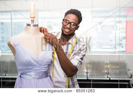 Portrait of male fashion designer and mannequin